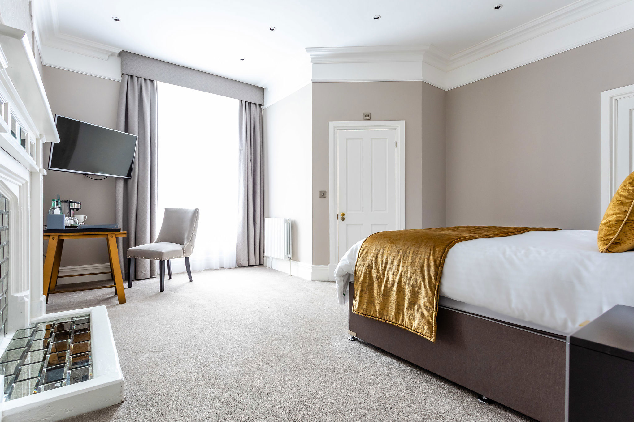 classic hotel room with golden bedspread