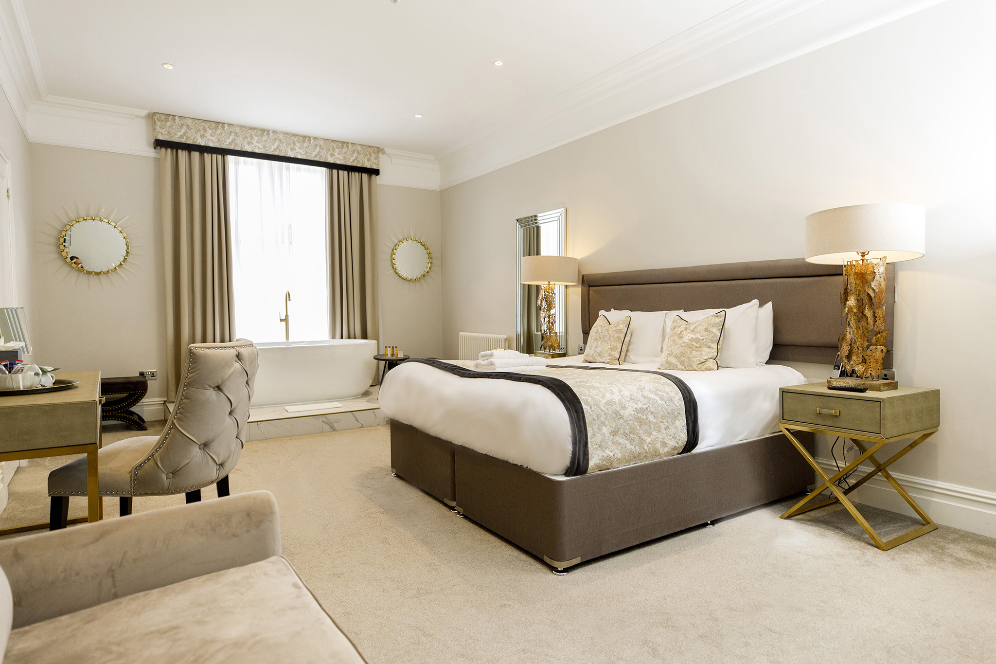 Luxury Deluxe Suite with large super king bed and free-standing bathtub